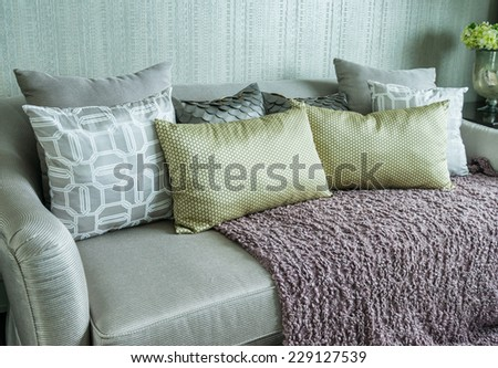 living room with row of pillows on sofa at home
