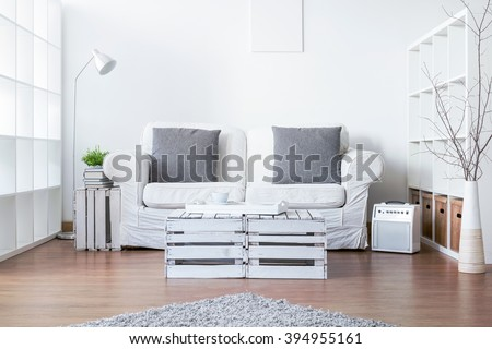 Living room with sofa and handmade small table - stock photo