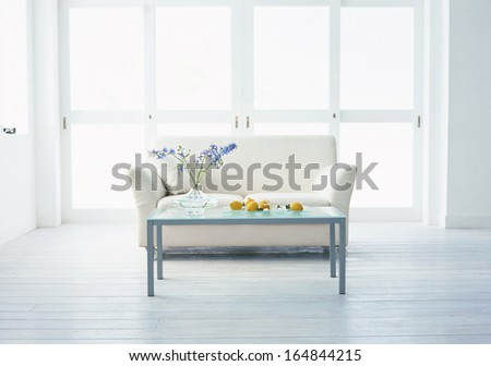 living room with sofa and table - stock photo