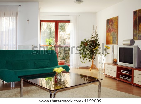 Living room with view on garden - stock photo