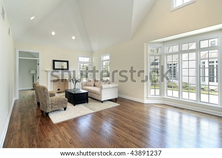 Living room with wall of windows - stock photo