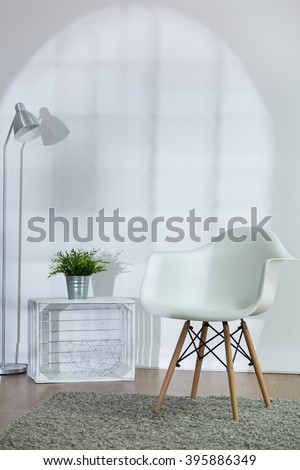 Living room with white walls and white decorations and wooden parquet with carpet - stock photo