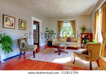 Living Room With Yellow Curtains Grey Walls And Antique Sofas