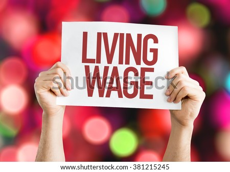 Living Wage placard with bokeh background - stock photo