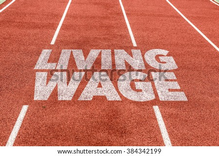 Living Wage written on running track - stock photo