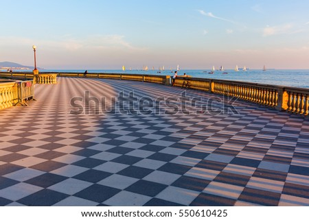 Livorno, Italy - July 01, 2016: Terrazza Mascagni with unidentified people. Its a wide sinuous belvedere toward the sea with a paving surface of 8700 sqm like a checkerboard and 4,100 balusters