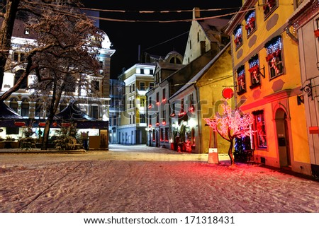 Livu square with Christmas market in a heart of Old Riga, Latvia at night with Russian Theater of Drama in a background - stock photo