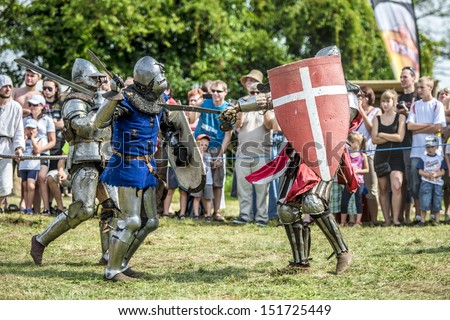 LIW, POLAND 17 AUGUST: Members of Medieval Reenactment Order fight in Liw Tournament on 17 August 2013 in Liw, Poland