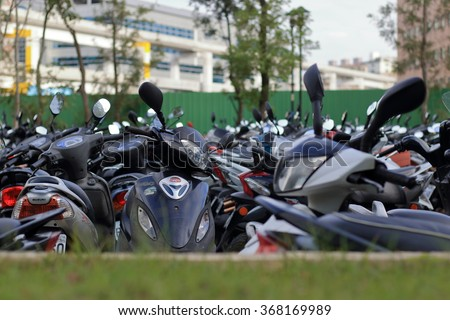 Liyan St., Zhonghe Dist., New Taipei City, Taiwan - Jan. 27, 2016: Many motorcycles in the parking lot.