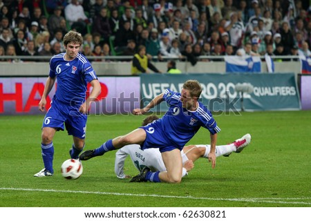 LJUBLJANA, SI - OCTOBER 8: Slovenian soccer players (white dresses) play a match against Faroe Islands in qualification for Euro 2012 in Ljubljana, Slovenia, EU. Slovenia win the match 5:1.