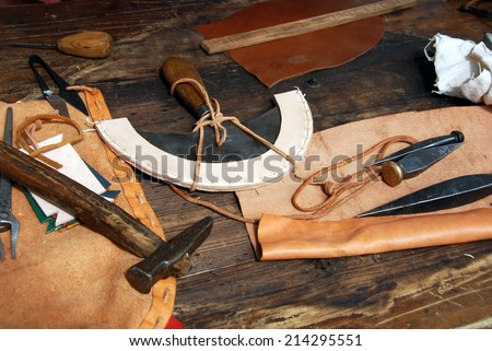 LJUBLJANA, SLOVENIA - AUGUST 24, 2014: Leather dresser's tools (presented by historical society Legio I Italica) in a revived Roman military camp at celebration of 2000th anniversary of Emona.