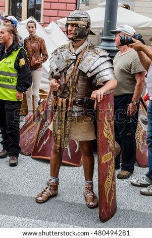 "LJUBLJANA, SLOVENIA - AUGUST 24th 2014: Ancient Roman legionnaire standing, leaning on his shield on the Ljubljana street on a summer afternoon as a part of ""Ave Emona"" event."
