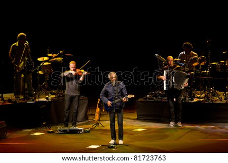 LJUBLJANA, SLOVENIA - JULY 26: Brazilian singer, guitarist and songwriter Gilberto Gil perform during a concert at Open Air Theater on July 26, 2011 in Ljubljana, Slovenia. - stock photo