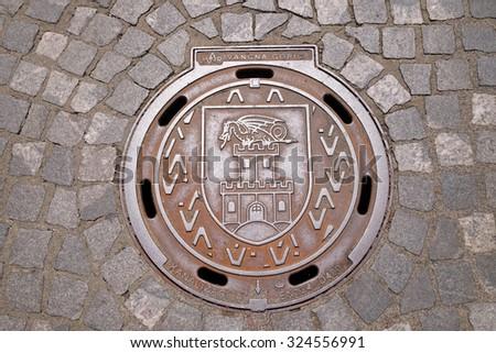 LJUBLJANA, SLOVENIA - JUNE 30: Hatch cover with the coat of arms of Ljubljana, Slovenia on June 30, 2015 - stock photo
