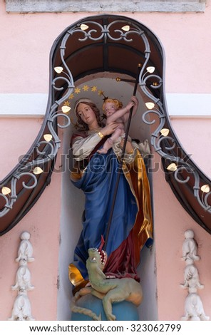 LJUBLJANA, SLOVENIA - JUNE 30: Virgin Mary with baby Jesus, statue on the house facade in Ljubljana, Slovenia on June 30, 2015 - stock photo