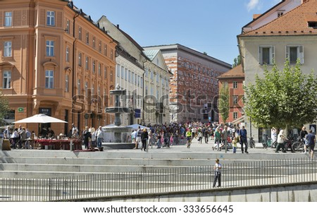 LJUBLJANA, SLOVENIA - SEPTEMBER 06, 2015: People walk on Novi (New) city square. Ljubljana is the capital and largest city of independent Slovenia since 1991.