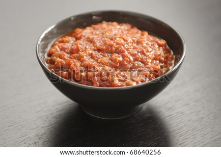 Ljutenica or Lutenica  ((ljuto, lyuto or luto meaning spicy) is a national relish of Bulgaria.  The ingredients: tomatoes, peppers, onion, garlic, black pepper, vegetable oil, sugar and salt.
