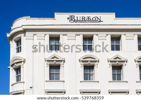 LLANDUDNO, WALES, UK - AUGUST 31, 2016: Vintage Burton fashion store sign in Llandudno,Wales, UK. Montague Burton founded a British menswear retailer, part of Arcadia Group.