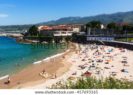 LLANES, SPAIN - JULY 3, 2015: Beach of Llanes in summer day