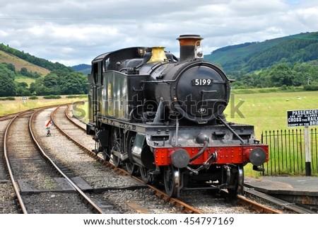 LLANGOLLEN, WALES - JULY 10: Classic locomotive at Corwen on the Llangollen Steam Railway, a seven mile former Great Western Railway branch line. July 10, 2016 in Llangollen, Wales. - stock photo