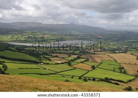 Llangorse Lake viewed from Mynydd Llangorse, Llangors, Brecon Beacons, Powys, Wales - stock photo