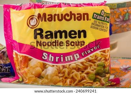 LLANO, TEXAS-DEC 30, 2014:  Bag of Shrimp Flavor Maruchan Ramen Noodle Soup with Orental Dishes. - stock photo