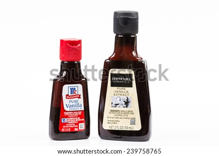 LLANO, TEXAS-DEC 24, 2014:  Pure Vanilla Extract is a most important element of any Homemaker's baking ingredients.  McCormick and Stonemill brands on white background. - stock photo