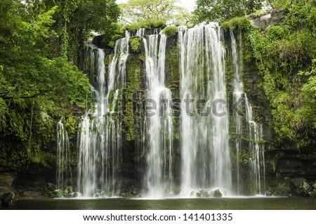 Llanos de Cortez Waterfall located in Costa Rica. - stock photo