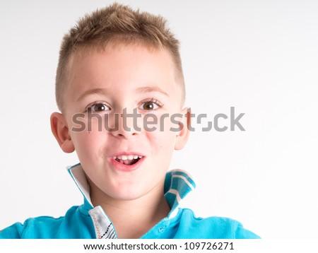 lLittle boy close up portrait - isolated on white background - stock photo