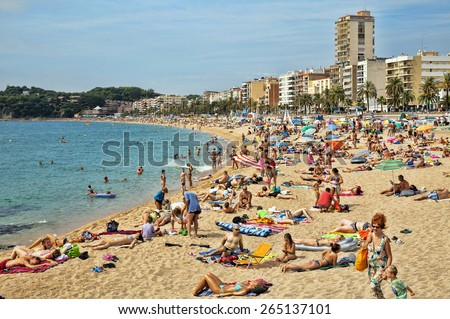 LLORET DE MAR, SPAIN - SEPTEMBER 01, 2014: A crowd of vacationers enjoy the warm beaches of Costa Brava in Lloret de Mar. - stock photo