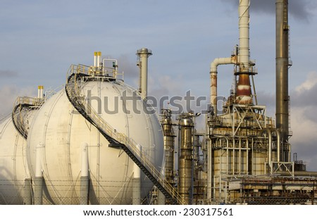 Lng gas storage tank and petrochemical plant  - stock photo