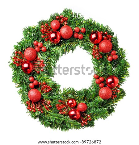 Loaded Christmas wreath isolated on white - stock photo