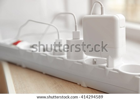 Loaded power strip - stock photo