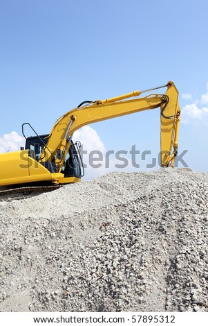 Loader excavator doing construction works - stock photo
