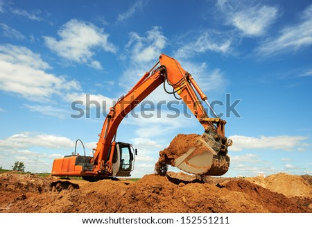 loader excavator machine doing earthmoving work at sand quarry - stock photo