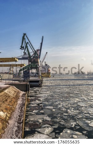 Loading a ship on a frosty winter morning in the port gdansk, Poland - stock photo