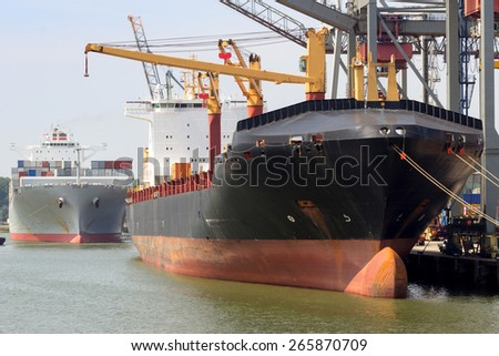 Loading and unloading of container-ships. - stock photo