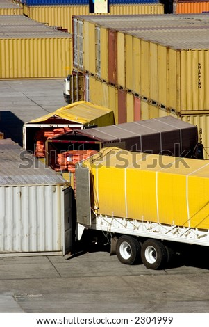 loading cargo containers from trucks - stock photo