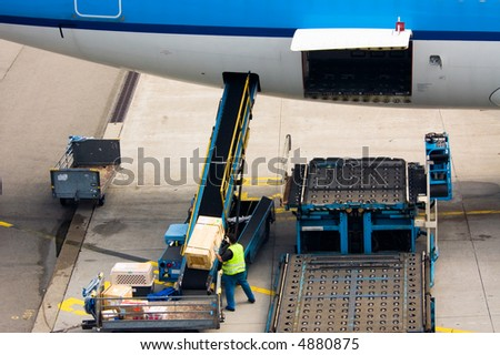 loading cargo on a big plane - stock photo
