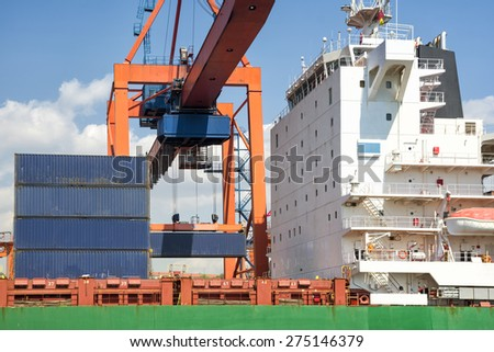 Loading Cargo On A Ship - stock photo