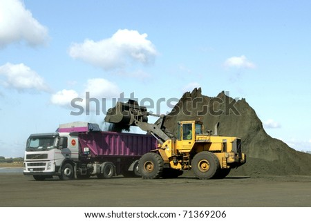 loading coal, in a port - stock photo