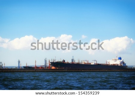 Loading container cargo ship in port Gdansk, Poland. - stock photo