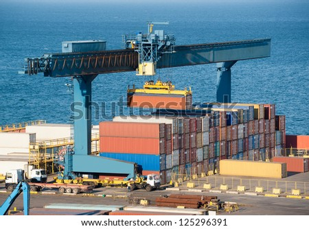loading container on truck in port - stock photo
