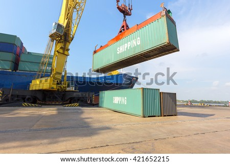 loading Containers box from Cargo freight ship with big crane - stock photo