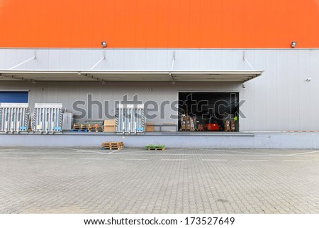 Loading dock and ramp at distribution warehouse - stock photo