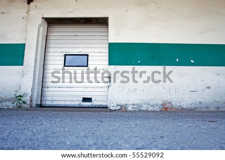 Loading dock and ramp, dirty exterior. - stock photo