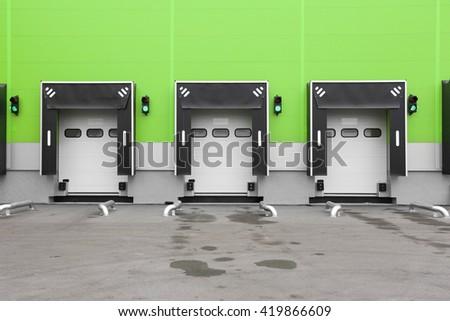 Loading Dock Bay Doors at Distribution Warehouse - stock photo