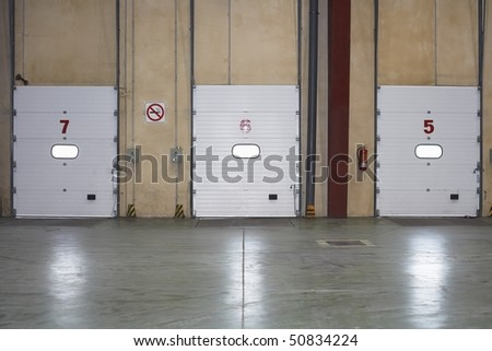 Loading Dock Doors in warehouse - stock photo