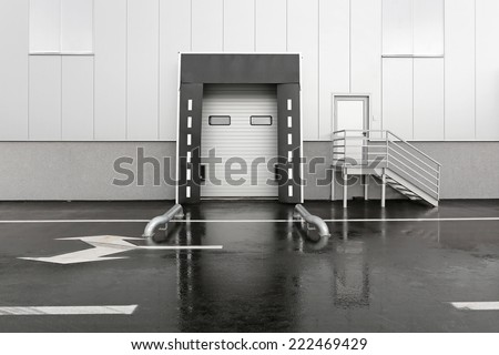 Loading dock for trucks at distribution warehouse - stock photo