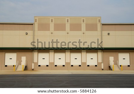Loading dock of a new commercial warehouse building - stock photo